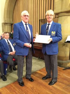 Fred Armstrong receiving a Long Service Recognition Award from Chairman Bob Brind at The 2016 Christmas Concert